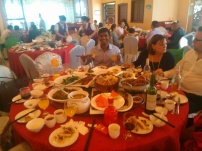 Joseph overwhelmed with food at the wedding